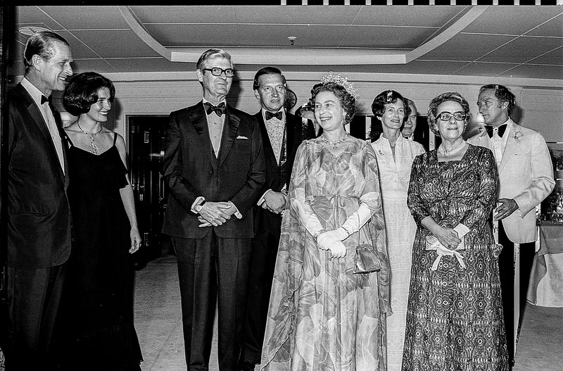 Prior to opening the Olympic Games in Montreal in 1976, Queen Elizabeth and Prince Phillip made a brief visit to Halifax. Posing for a photo aboard the Royal Yacht Britannia are left to right: Prince Philip, Margaret Trudeau, wife of Prime Minister Trudeau, Governor General Jules Legere, Nova Scotia Premier Gerald Regan,  The Queen. Mrs. Regan, Mrs. Legere and Prime Minister Trudeau. (CP Wirephoto) 1976 (Wally Hayes)