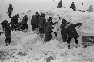 Canadian soldiers dig through massive deposits of ice in snow after an avalanche wiped out the Granduc Mining camp in northern British Columbia on Feb. 18, 1965. Two miners perished at the copper mine located 22 miles north of Stewart, BC., near the border with the Alaskan panhandle. (CP Wirephoto)1965(Wally Hayes)