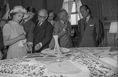 Queen Elizabeth and Prince Andrew are shown a model of Montreal's Olympic Stadium by Montreal Mayor Jean Drapeau during a visit to city hall in 1976. Behind Mr. Drapeau is Jean Chretian who was to later become Canada's Prime Minister. Next to him is Roger Taillibert, architect for the stadium, talking with Prince Phillip.  (CP Wirephoto) 1976 (Wally Hayes)