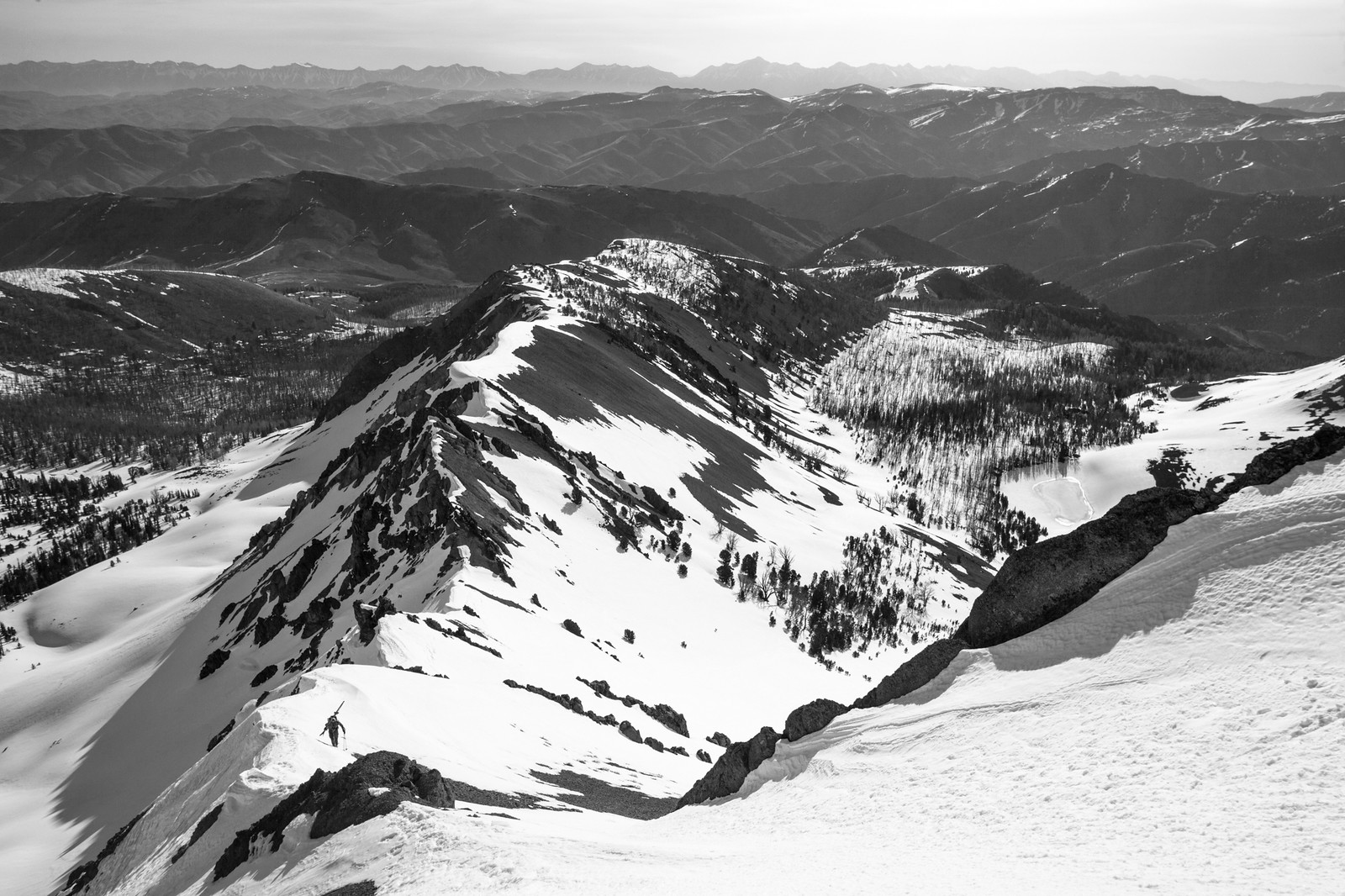 Randy Flood works his way up the East Ridge of Bowery Peak.  Lake 9,346 can be seen below.