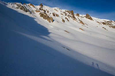 Assessing the options down the north face of Bowery Peak.