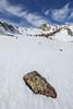 Rock, lichen, snow, and the NE face of Peak 10,843