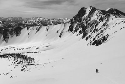 The expansive SE face of Bowery Peak with Peak 10,843 and the Pioneer mountains in the distance.