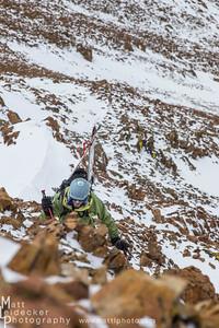 Tim Cron picks his way up the summit ridge.