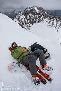 Tim Cron takes a break during a rare windless afternoon on a Boulder summit.