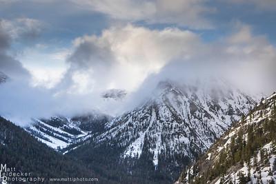 Storm clouds envelop the peaks surrounding West Pass.