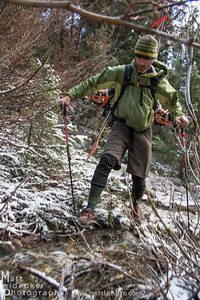 Tim Cron picks his way across a key handrail creek that helped us gain the main basin.