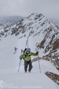 Tim Cron climbs in front of the N face of Peak 11,546