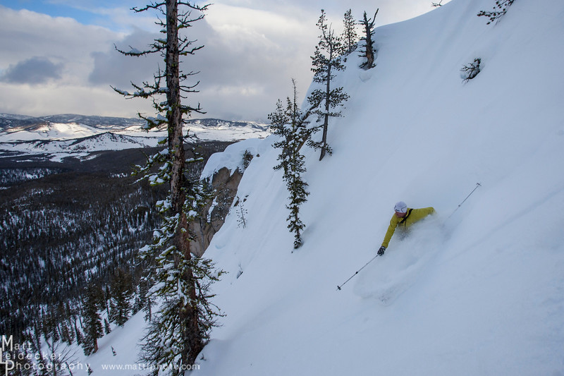 Craig enjoys some cold powder preserved in the north couloirs above camp.