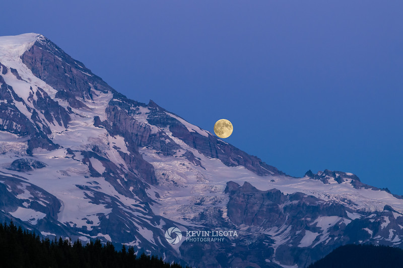 Full moon rises over Mt. Rainier
