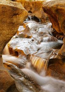 Water from Santiago Creek cascades through Blackstar Canyon