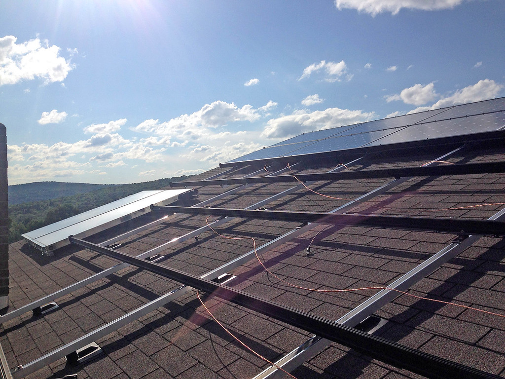 "<div class=""jaDesc""> <h4> Solar Panels Being Installed - August 18, 2014</h4> <p> The mounting racks for the solar panels are in place and 14 of the 38 panels are installed.  The 2 panels at the far end are the solar hot water collector.</p>  </div>"