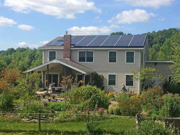 """<div class=""""jaDesc""""> <h4> Solar Panels on House - August 26, 2014 - Video Attached</h4> <p> This photo of our solar electric panels installed on our south facing roof along with our 2 solar hot water panels was taken from our barn roof.  It is nice to see our net meter showing that we are producing more than we are using. </p>  </div> <center> <a href=""""http://www.youtube.com/watch?v=kxVwH0pVcP4"""" style=""""color: #0AC216"""" class=""""lightbox""""><strong> Play Video</strong></a> </center>"""
