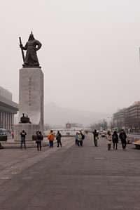 Statue of Yi Sun-sin in Gwanghwamun Plaza, with Sejong the Great and Gyeongbukgung in the distant background.
