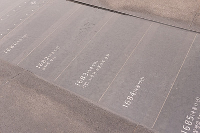 On the edge of the plaza, Korean history is depicted on these small slabs underneath gently flowing water.
