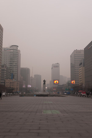 The rear of the statue of Yi Sun-sin in the distance.  The entrance to the subway is just before it.