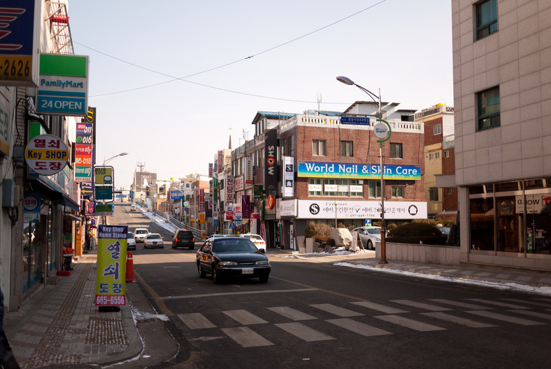 A big street in Songtan.  The bridge in the distance leads over the KTX / subway railroad tracks.