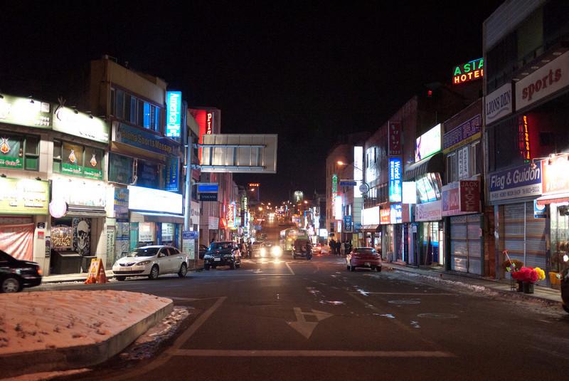 A street in Songtan at night near Osan Air Base.