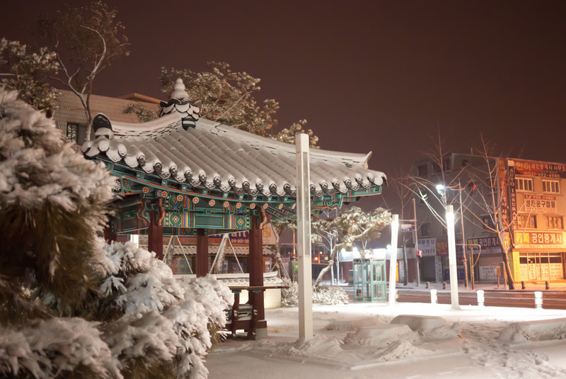 A small snow covered plaza in Anjung-ri.