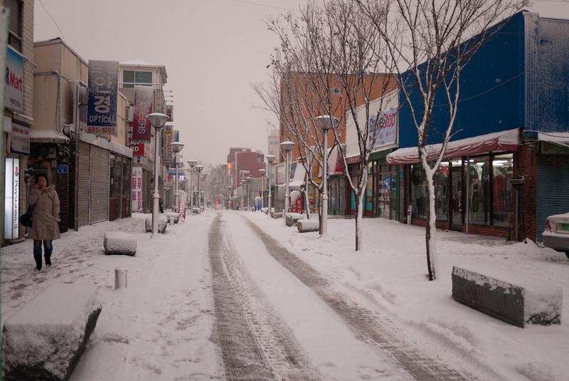 Snowy street outside of the Humphreys walk through gate.