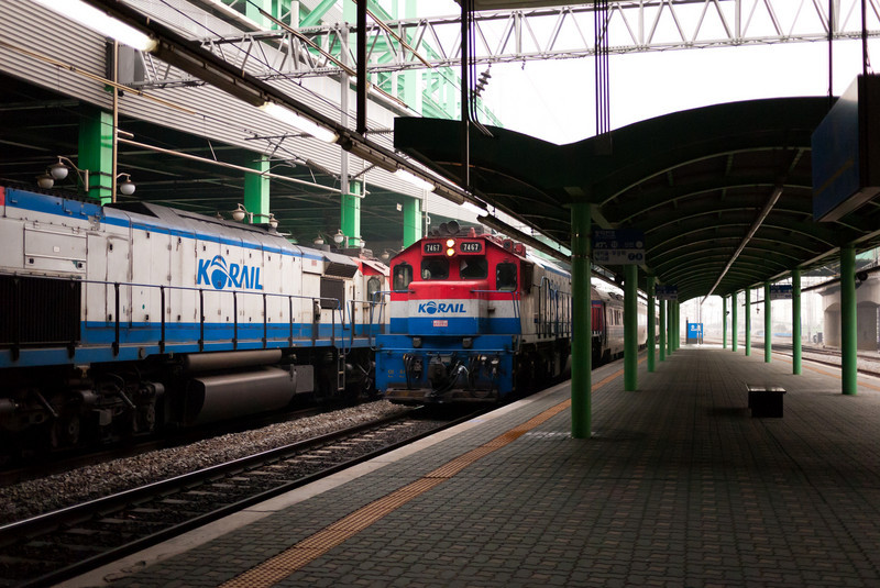 Two diesel powered trains at Suwon Station.