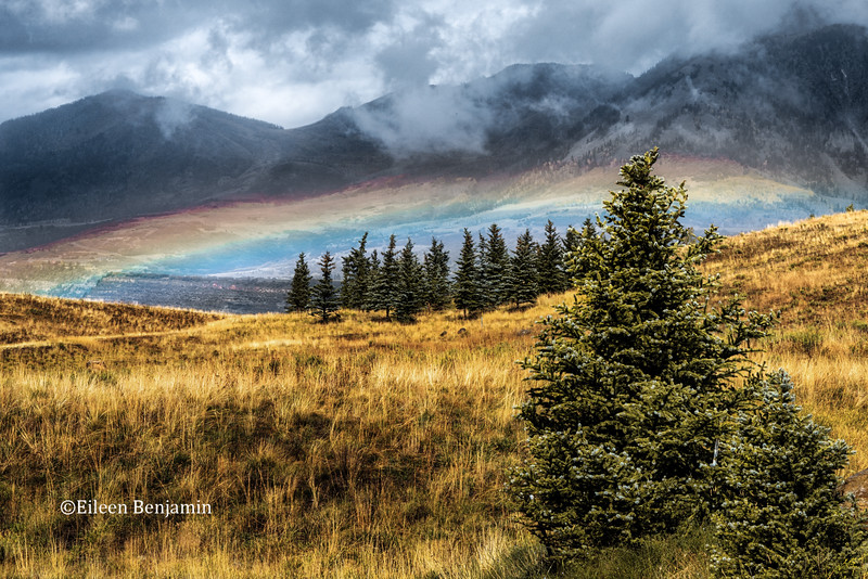 Rainbow and Breaking Clouds
