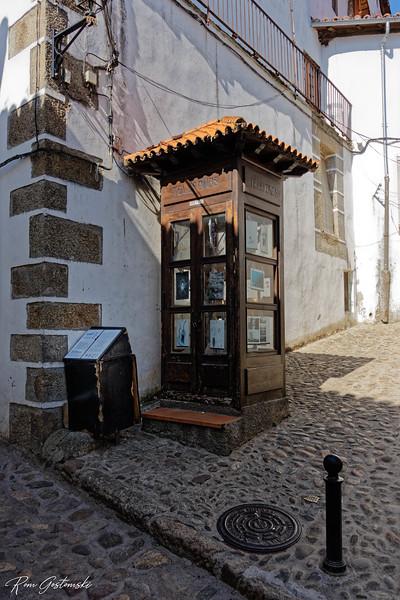 A phone box.
