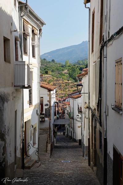 A narrow steep street.
