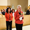 Arlene DeLucca & Tessie offer wine at Holy Communion