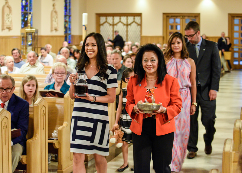 Liwanag family brings bread & wine to the church altar