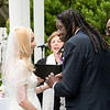 Jabreel placing the wedding band on Lisa