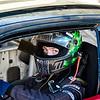 male driver sitting in car_#2_helmet on