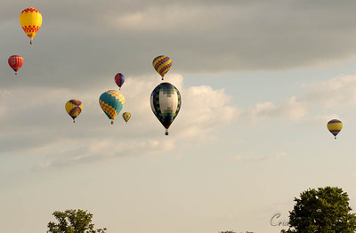 There they go....chasing a balloon out over Middletown during that evening's competition at Challenge Ohio.
