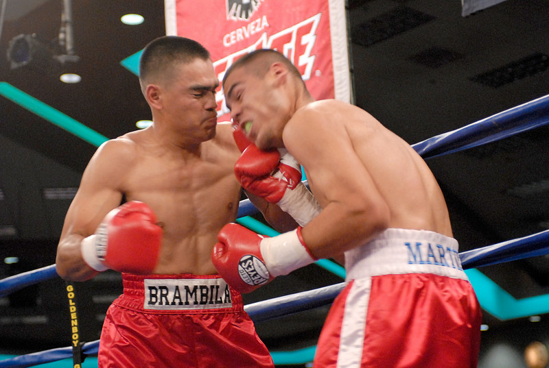 (3.30.2007 - Desert Diamond Casino)  Arturo Brambila scores on Gabriel Martinez during their 8 round Welterweight bout.  Martinez went to win a split decision.