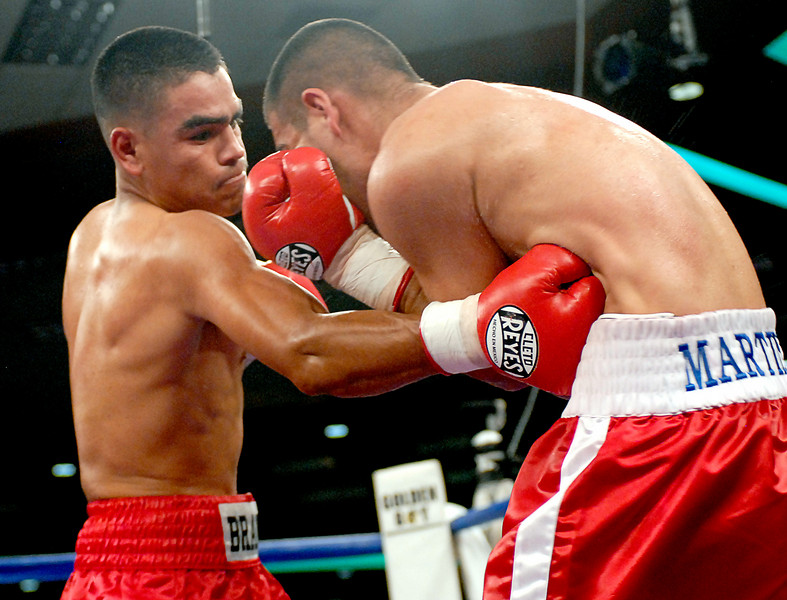 (3.30.2007 - Desert Diamond Casino)  Arturo Brambila connects with a solid shot to the mid-section of Gabriel Martinez in the 6th round of their Welterweight bout.  Nonetheless, Martinez went on to win a split decision.