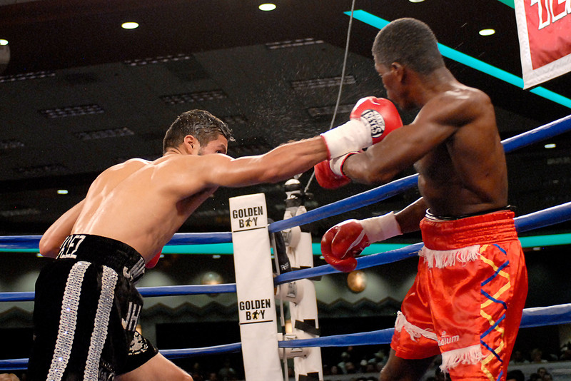 (3.30.2007 - Desert Diamond Casino)  Jhonny Gonzalez keeps the pressure on Irene Pacheco in the 8th round of their WBO Bantamweight Championship bout.