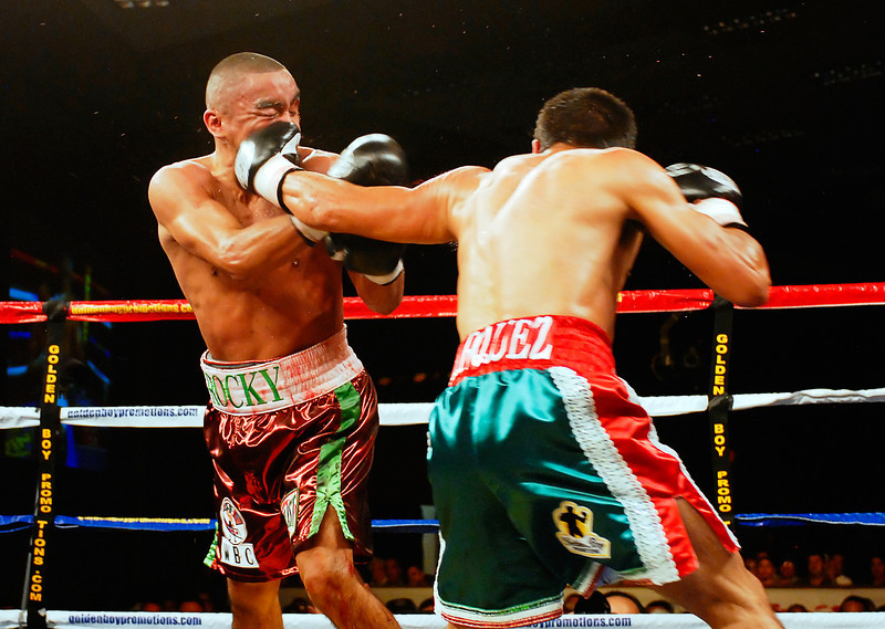 (11.3.2007 -- Tucson, Arizona)  Juan Manuel Marquez lands a left to the face of Rocky Juarez in the 7th round of their World Boxing Council Super Featherweight title bout.  Marquez went on to win a 12 round unanimous decision and successfully defend his title.<br /> <br /> <br /> Images from the November 3, 2007 Golden Boy Productions fight card at the Desert Diamond Casino.