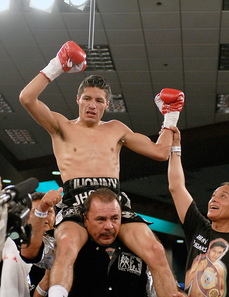 (3.30.2007 - Desert Diamond Casino)  Jhonny Gonzalez celebrates his 9th round TKO victory over Irene Pacheco.  Gonzalez retained his WBO Bantamweight Championship title.