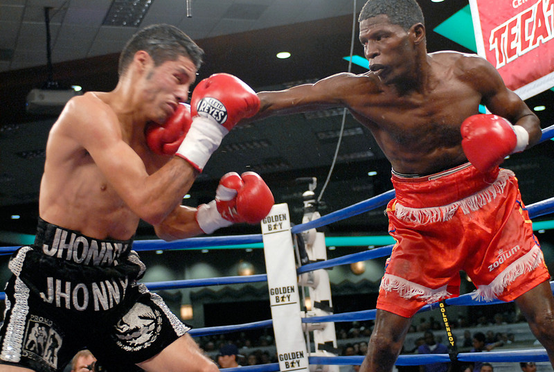(3.30.2007 - Desert Diamond Casino)  Irene Pacheco valiantly fights back against Jhonny Gonzalez' withering attack in the 9th round of their WBO Bantamweight Championship bout.  Later that round, Gonzalez scored a TKO and successfully defended his title.