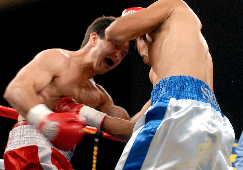 (11.3.2007 -- Tucson, Arizona)  Jesus Selig lands a shot to the body of Daniel Gonzales, in their bout at the Desert Diamond Casino.  Selig remained undefeated with a split decision.