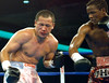(1.27.2006 - Desert Diamond Casino, Tucson, AZ)  Ouma scores on Mora in the 8th round of their NABO Championship bout.