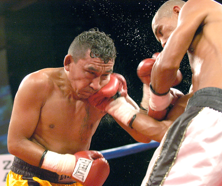 (7-30-2005)  Oscar Andrade (right) scores with a right hand to the face of Paulino Villalobos in the 7th round of their 12 round WBO Latino Bantamweight Fight at the Desert Diamond Casino.  Andrade won a 12 round unanimous decision.
