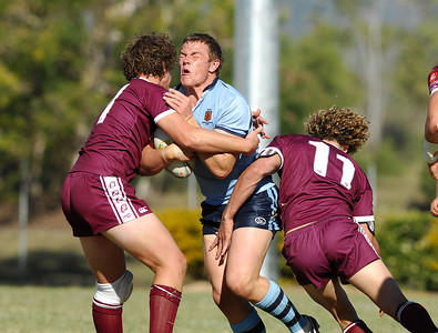 TOWNSVILLE, QLD 14 JUL 2007 - NSW's Martin Kennedy is wrapped up by the QLD defence - New South Wales Combined High Schools v Queensland Secondary Schools Rugby League / 2007 Under-18 Australian Schoolboys Rugby League Championships - PHOTO: CAMERON LAIRD (PH 0418 238811)