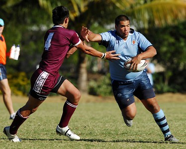 TOWNSVILLE, QLD 14 JUL 2007 - NSW's Matthew Mundine palms off QLD's Daniel Vidot - New South Wales Combined High Schools v Queensland Secondary Schools Rugby League / 2007 Under-18 Australian Schoolboys Rugby League Championships - PHOTO: CAMERON LAIRD (PH 0418 238811)