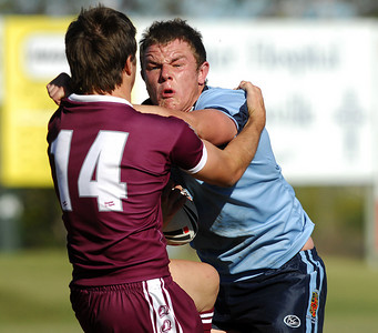 TOWNSVILLE, QLD 14 JUL 2007 - QLD's Ben Hunt tries to stop a rampaging Martin Kennedy - New South Wales Combined High Schools v Queensland Secondary Schools Rugby League / 2007 Under-18 Australian Schoolboys Rugby League Championships - PHOTO: CAMERON LAIRD (PH 0418 238811)