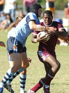 iTOWNSVILLE, QLD 14 JUL 2007 - QLD fullback Robert Louis (Keebra Park SHS) tries to escape the NSW defence - New South Wales Combined High Schools v Queensland Secondary Schools Rugby League / 2007 Under-18 Australian Schoolboys Rugby League Championships - PHOTO: CAMERON LAIRD (PH 0418 238811)