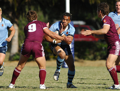 TOWNSVILLE, QLD 14 JUL 2007 - Mark Talanoa runs at QLD's Jake Friend - New South Wales Combined High Schools v Queensland Secondary Schools Rugby League / 2007 Under-18 Australian Schoolboys Rugby League Championships - PHOTO: CAMERON LAIRD (PH 0418 238811)
