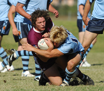 TOWNSVILLE, QLD 14 JUL 2007 - QLD's Kevin Proctor is wrapped up by NSW's Brad Hudson - New South Wales Combined High Schools v Queensland Secondary Schools Rugby League / 2007 Under-18 Australian Schoolboys Rugby League Championships - PHOTO: CAMERON LAIRD (PH 0418 238811)