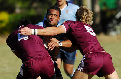 TOWNSVILLE, QLD 14 JUL 2007 - NSW's Mark Talanoa is smashed by QLD's defence of Daniel Vidot (5) and Ryan Williamson (5) - New South Wales Combined High Schools v Queensland Secondary Schools Rugby League / 2007 Under-18 Australian Schoolboys Rugby League Championships - PHOTO: CAMERON LAIRD (PH 0418 238811)