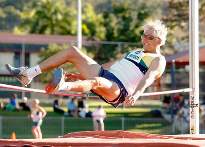 31 July 2008 Townsville, Qld - Competition at the 2008 Oceania Masters athletics meet in Townsville.  Nye Evans brushes the bar in the 70-74 age group high jump - Photo: Cameron Laird (Ph: 0418 238811)